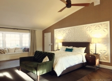 California contemporary bedroom suite with king bed, wall tiles, and velvet settee