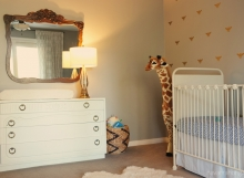Natural eclectic nursery with dresser and mirror