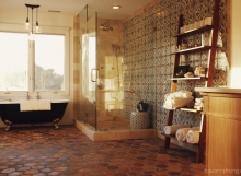 Spanish modern bath - Shower and clawfoot tub with wooden shelf and Spanish floor and wall tile