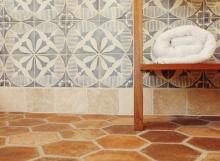 Spanish modern bath - Closeup painted wall tile and hexagon Spanish clay floor tile