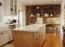 Contemporary rustic kitchen with brick wall and white quartz countertops
